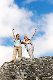 Summit women mountain. Happy hiking women have made it to the summit and they raise their arms up in joy stock photos