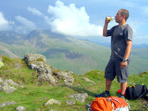 Summit of Yewbarrow, Cumbria. A fell walker relaxing with a drink on the summit of Yewbarrow,Cumbria,England,UK Stock Image