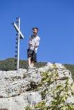 Summiteer, adolescente que hace una actitud del ganador Fotos de archivo