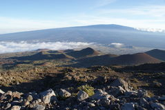 Summiting Above the Clouds on Mauna Kea Stock Images