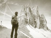 Summits of Alps mountains. Tourist walk with backpack royalty free stock photography