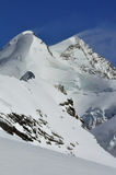 Summits and blown snow Stock Photo
