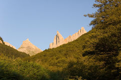 Summits of Pyrenees over the forest royalty free stock images