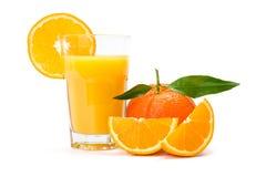Sumo de laranja no vidro imagem de stock