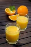 Sumo de laranja no vidro Foto de Stock Royalty Free