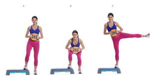 Sumo Squat and Leg Raise with disc weight on a step Royalty Free Stock Photo