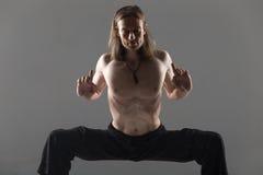 Sumo wrestler yoga pose stock image