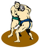Sumo wrestlers fighting Stock Images