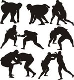 Sumo wrestlers silhouettes and icon Royalty Free Stock Photos