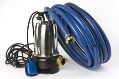 Sump Pump And Water Hose Royalty Free Stock Photos