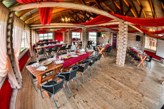 Sumptuous Banquet in a wooden gazebo is beautifully decorated in  traditional style Stock Photography