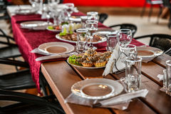 Sumptuous Banquet in a wooden gazebo is beautifully decorated in traditional style. Sumptuous Banquet in a wooden gazebo is beautifully decorated in a Stock Photo