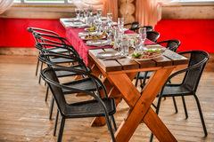 Sumptuous Banquet in a wooden gazebo is beautifully decorated in traditional style. Sumptuous Banquet in a wooden gazebo is beautifully decorated in a Stock Images