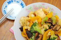Sumptuous Chinese style cuisine. Sumptuous, home cooked Chinese vegetarian cuisine. Ingredients include green and white cauliflower, mushrooms, and carrots Stock Photo
