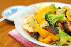 Sumptuous Chinese style cuisine. Sumptuous, home cooked Chinese vegetarian cuisine. Ingredients include green and white cauliflower, mushrooms, and carrots Royalty Free Stock Image