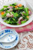 Sumptuous Chinese style vegetables. Sumptuous, Chinese vegetarian cuisine. Ingredients include green, leafy vegetables, mushrooms, carrots, and slices of ginger Stock Image