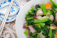 Sumptuous Chinese style vegetables. Sumptuous, Chinese vegetarian cuisine. Ingredients include green, leafy vegetables, mushrooms, carrots, and slices of ginger Royalty Free Stock Image