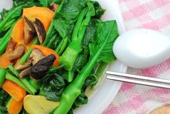 Sumptuous Chinese vegetarian cuisine. Sumptuous, home cooked Chinese vegetarian cuisine. Ingredients include green, leafy vegetables, mushrooms, carrots, and Stock Photo