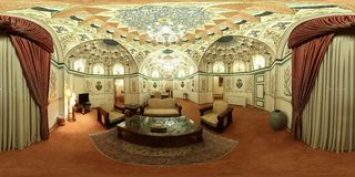 Sumptuous luxurious Middle East palace mansion hall - empty wide angle view. The luxury of an Isfahan palace showing Islamic architecture elements on the ceiling Stock Photography