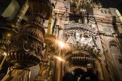 The sumptuousness interior and of burning candles of the Church of Holy Sepulchre, Jerusalem, Israel: October 24, 2018. The sumptuousness of interior and of stock photos