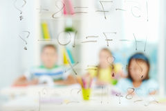 Sums on transparent board Stock Photo
