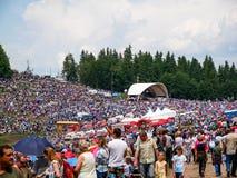 Crowd of catholic pilgrims celebrating the Pentecost. stock photo