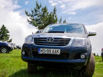 Parking Toyota Hilux front view near a pine forest. stock photo