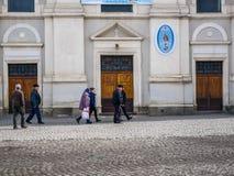 People walking in front of the local catholic church. Sumuleu Ciuc, Romania- 09 March 2019: People walking in front of the local catholic church stock photos