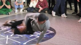 SUMY, UKRAINE-FEB 25, 2017: a young man dancing breakdance at Wild dances hip-hop dance festival. stock footage