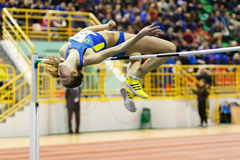 SUMY, UKRAINE - FEBRUARY 18, 2017: Klintsova Liliia performing high jump in final competition on Ukrainian indoor track and field. Championship 2017 stock photography