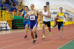 SUMY, UKRAINE - FEBRUARY 17, 2017: sportsmen running qualification race in the men`s 400m running in an indoor track and Stock Photos