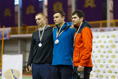 SUMY, UKRAINE - FEBRUARY 17, 2017: winners in pole vault competition in an indoor track and field event. Stock Image