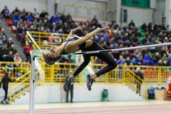 SUMY, UKRAINE - FEBRUARY 18, 2017: Yuliia Levchenko jumping over bar in final High Jump competition of Ukrainian indoor Royalty Free Stock Photography