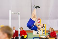 SUMY, UKRAINE - JANUARY 28, 2018: Vadym Kravchuk wins in high jump competition on Ukrainian indoor track and field team. Championship 2018 with result 2.15m Stock Photos