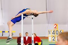 SUMY, UKRAINE - JANUARY 28, 2018: Vadym Kravchuk wins in high jump competition on Ukrainian indoor track and field team. Championship 2018 with result 2.15m Stock Photography