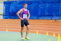 SUMY, UKRAINE - JANUARY 28, 2018: Vitaliy Butrym after win in 400m race on Ukrainian indoor track and field team. Championship 2018 Royalty Free Stock Photo