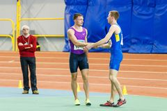 SUMY, UKRAINE - JANUARY 28, 2018: Vitaliy Butrym after win in 400m race on Ukrainian indoor track and field team. Championship 2018 Stock Photos