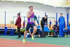 SUMY, UKRAINE - JANUARY 28, 2018: Vitaliy Butrym wins 400m race on Ukrainian indoor track and field team championship. 2018 Royalty Free Stock Image