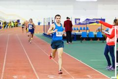 SUMY, UKRAINE - JANUARY 28, 2018: Volodymyr Kyts wins in 3000m race on Ukrainian indoor track and field team. Championship 2018 Stock Photo