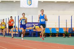 SUMY, UKRAINE - JANUARY 28, 2018: Volodymyr Kyts wins in 3000m race on Ukrainian indoor track and field team. Championship 2018 Royalty Free Stock Photos
