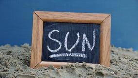 Sun écrit Photographie stock