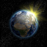 Sun, étoiles et terre de planète Image stock