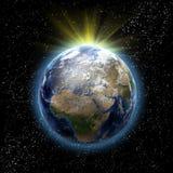 Sun, étoiles et terre de planète Photos stock