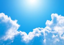 Sun. Cloud with sun on background blue sky Stock Photography