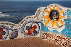 The Sun. Portrait of the girl in a mosaic wall at coast of Pacific ocean. Peru Stock Photo