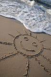 Sun-Abbildung auf dem Strand Stockfotos