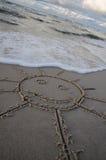 Sun-Abbildung auf dem Strand Lizenzfreie Stockbilder
