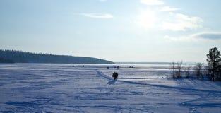 Sun above frozen lake Stock Image