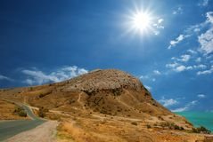 Sun above a mountain Stock Images