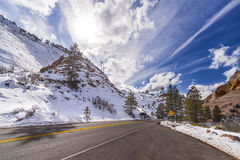 Sun above a mountain road in Zion National Park, Utah, USA. Stock Photos